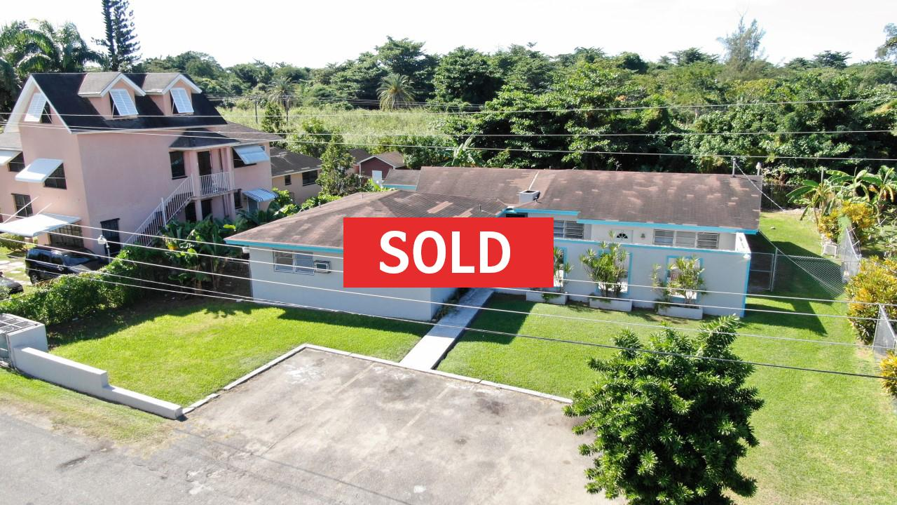 /listing-sold-stapledon-gardens-triplex-28017.html from Coldwell Banker Bahamas Real Estate