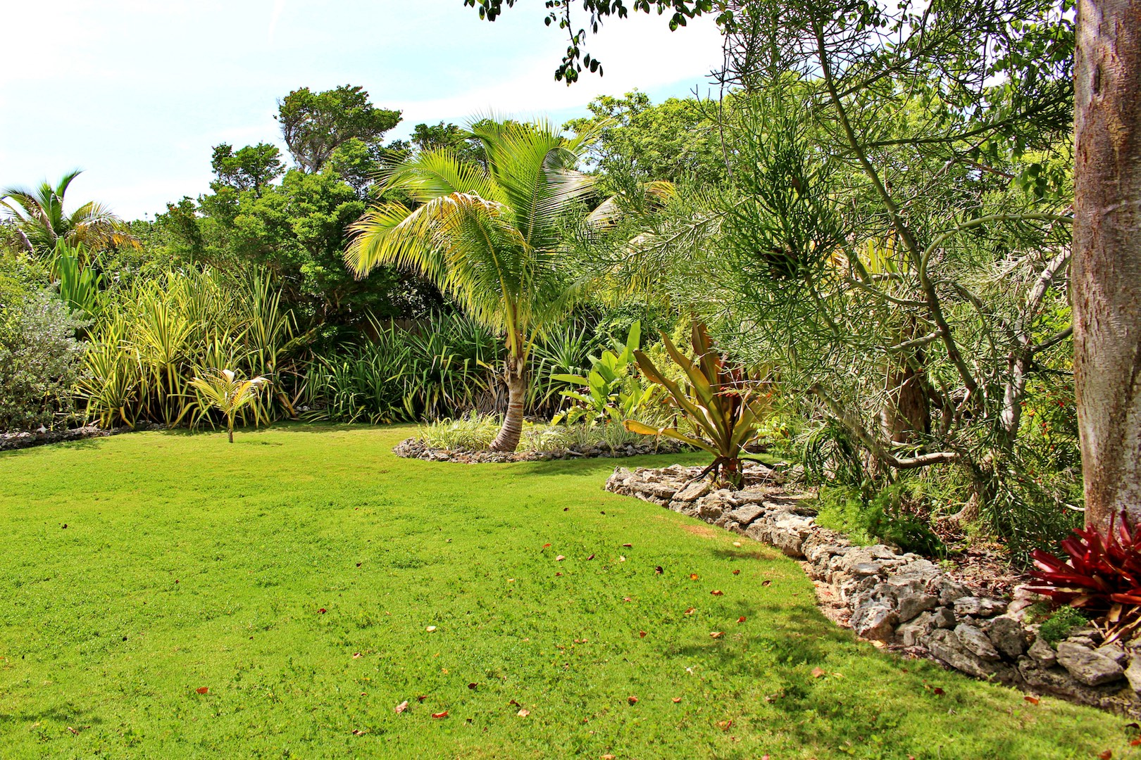 Green Turtle Cay home for sale with beach and dock landscaped acreage