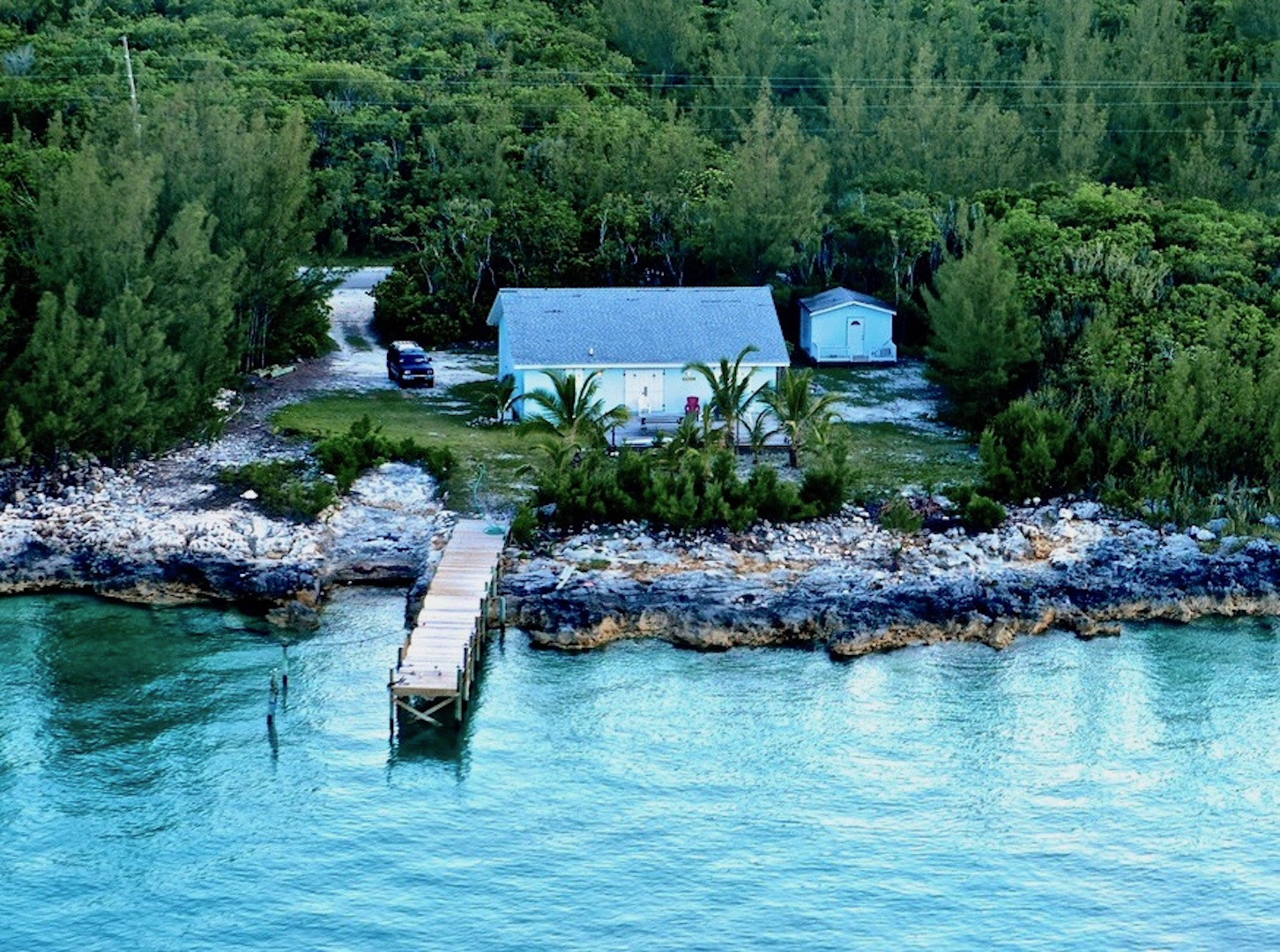 Waterfront home in Abaco with a dock and boat ramp