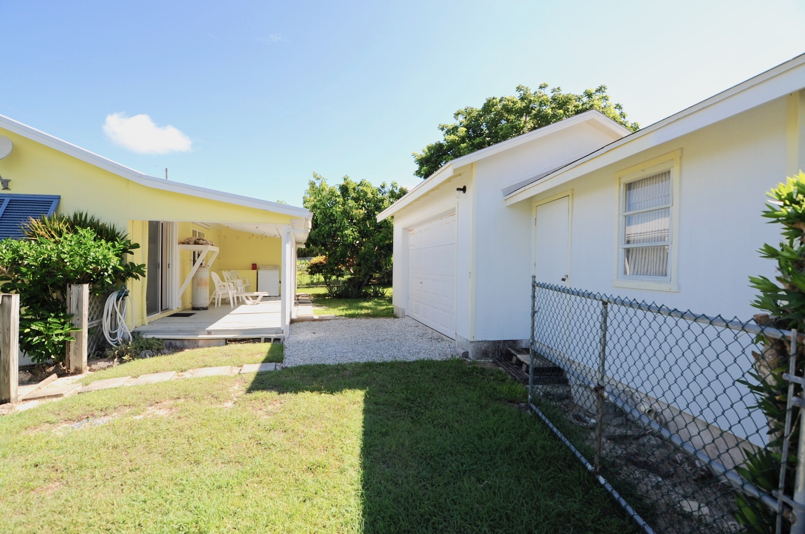 Home for sale in Man-o-war cay Abaco Bahamas with golf cart garage and owners lock up