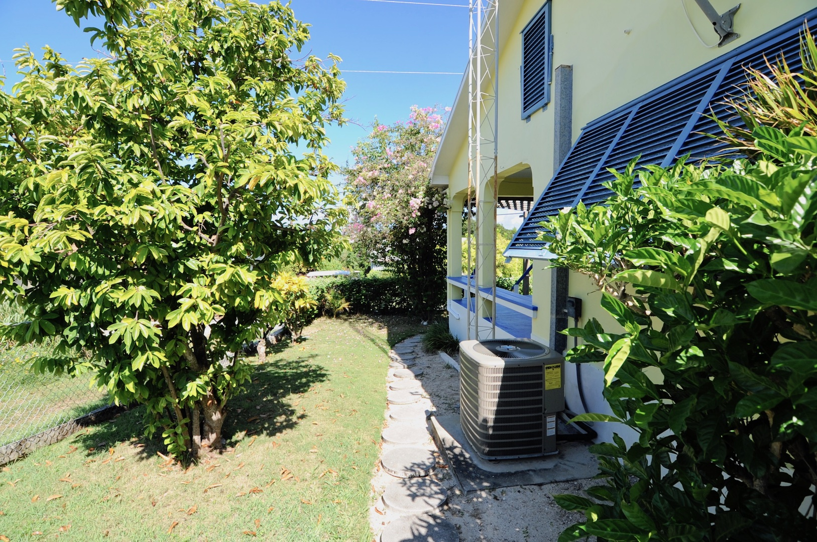 Home for sale in Man-O-War Cay Abaco Bahamas with mature fruit trees Sour Sop Avocados